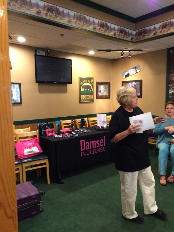 Linda Straley presenting to our BCBC members about Damsel Pro Gal, a division of Damsel in Defense